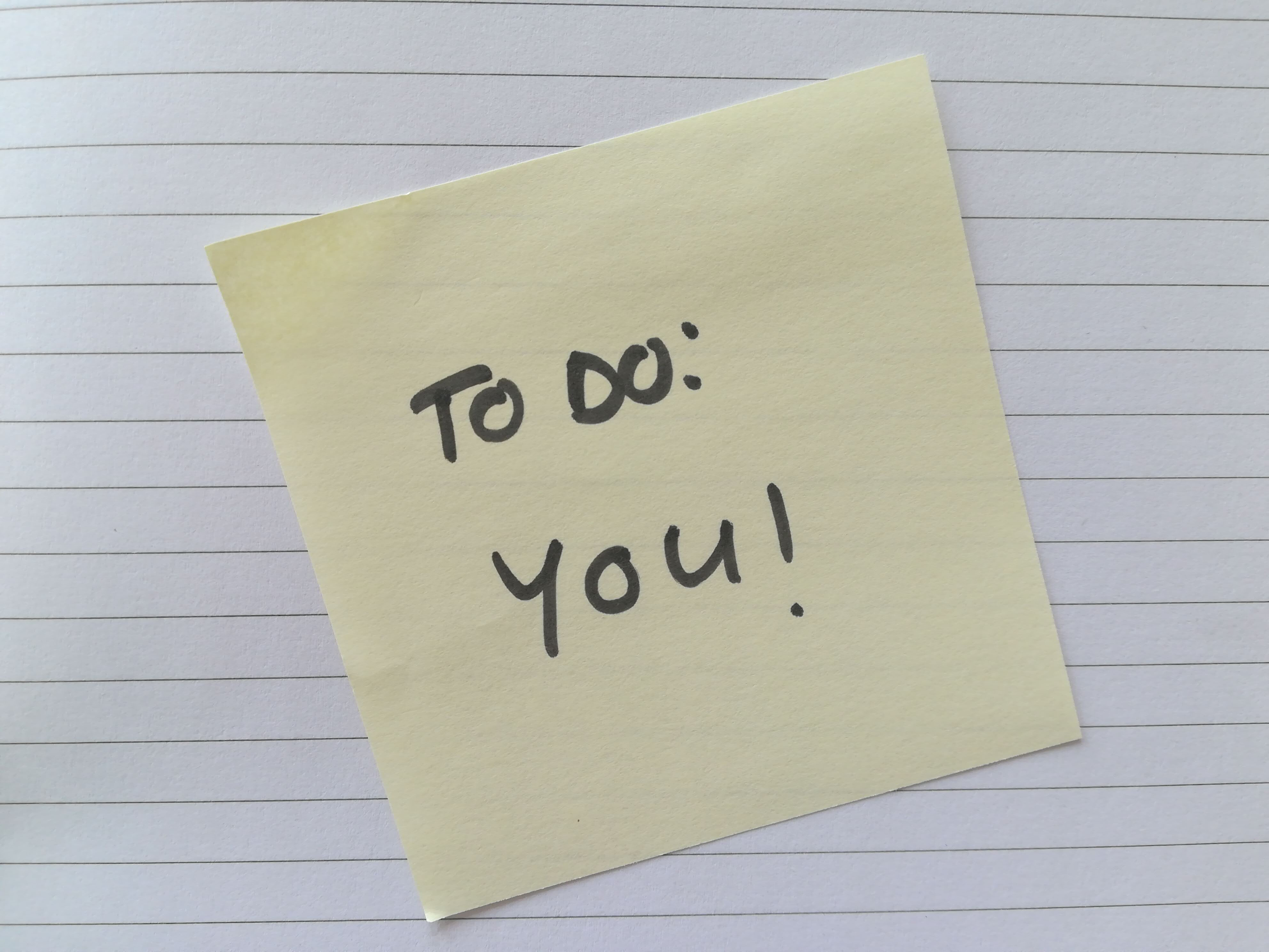 Post it note with text written on that says To do: you!